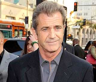 Mel Gibson crashes sports car into hillside